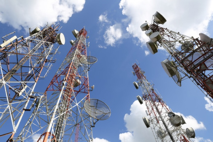 48256422 - telecommunication tower with blue sky and cloud