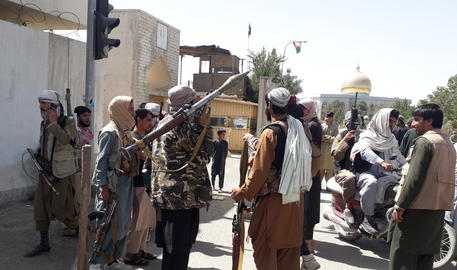 epa09410791 Taliban militants patrol after taking control of the Governor's house and Ghazni city, in Afghanistan, 12 August 2021. Taliban fighters on 12 August captured the strategic Ghazni province that connects the capital Kabul to other southern Afghan regions, officials and the insurgents said. The region became the 10th province to fall to the insurgents in a week in their major offensive toward Kabul after the United States-led foreign troops withdrew from the war-ravaged country.  EPA/NAWID TANHA