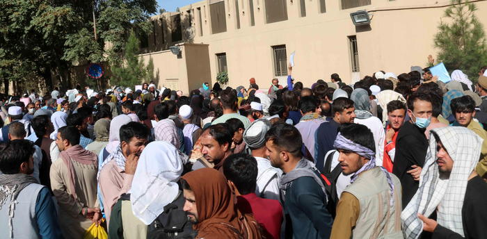 epa09428880 Afghans try to reach the airport after the Taliban announced they wouldn't allow access any longer, in Kabul, Afghanistan, 25 August 2021. Taliban spokesperson Zabiullah Mujahid said in a press conference on 24 August, that evacuation must be completed by August 31 and they will not allow Afghans to go to the airport from now on.  EPA/AKHTER GULFAM
